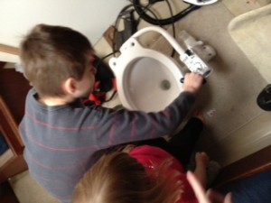 kids looking at the new toilet