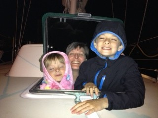Family watching fireworks from the forward hatch on Shannon